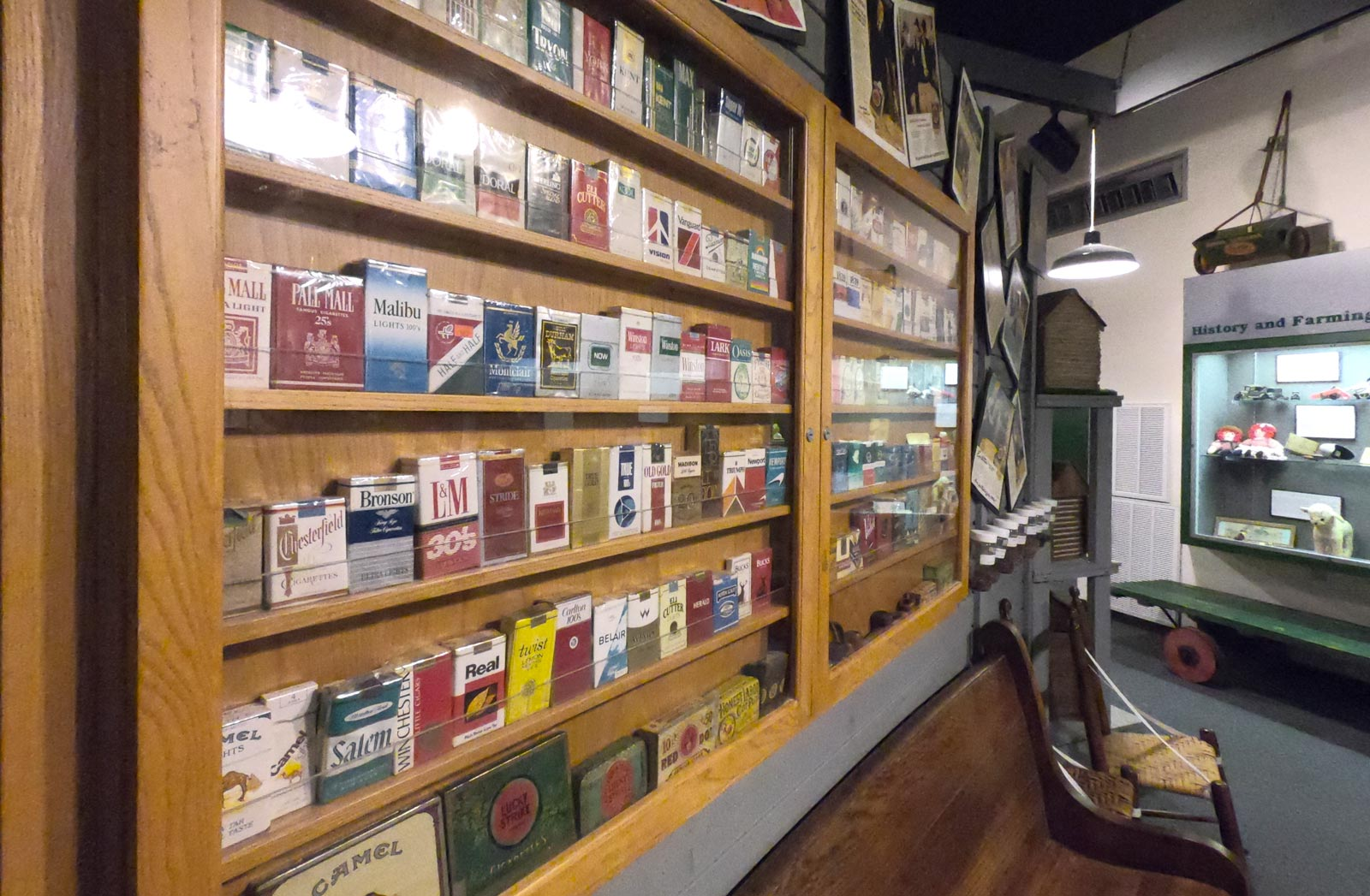 Indoor exhibit featuring different brands of cigarette packs at Tobacco Farm Life Museum, Kenly, North Carolina