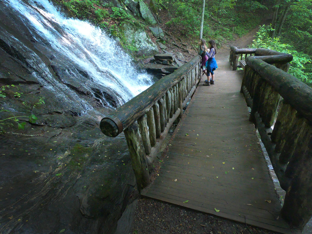Two girls on the footbridge at Juney Whank Falls in Deek Creek section of Great Smoky Mountains National Park, North Carolina