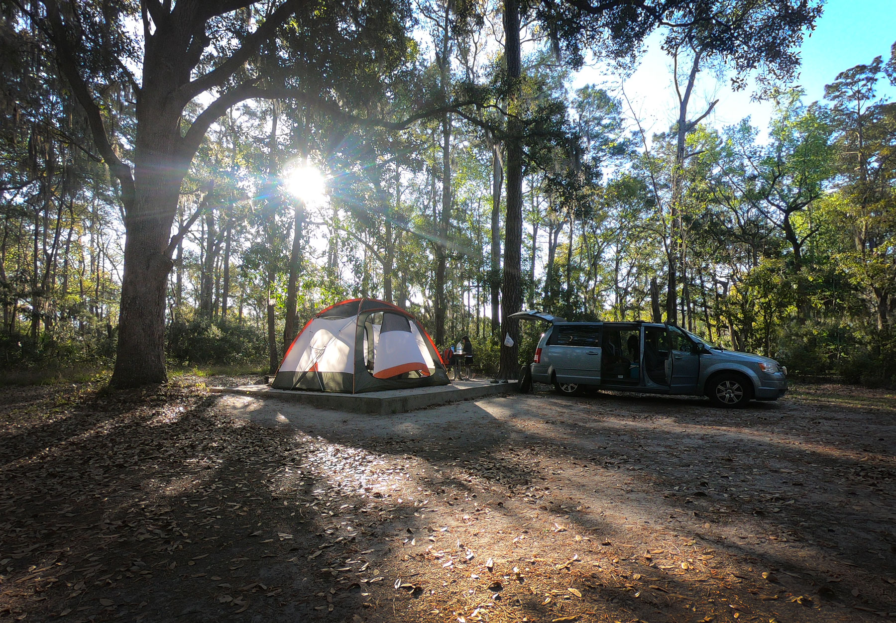 Setting up spacious campsite with tent and van at Skidaway Island State Park, Georgia