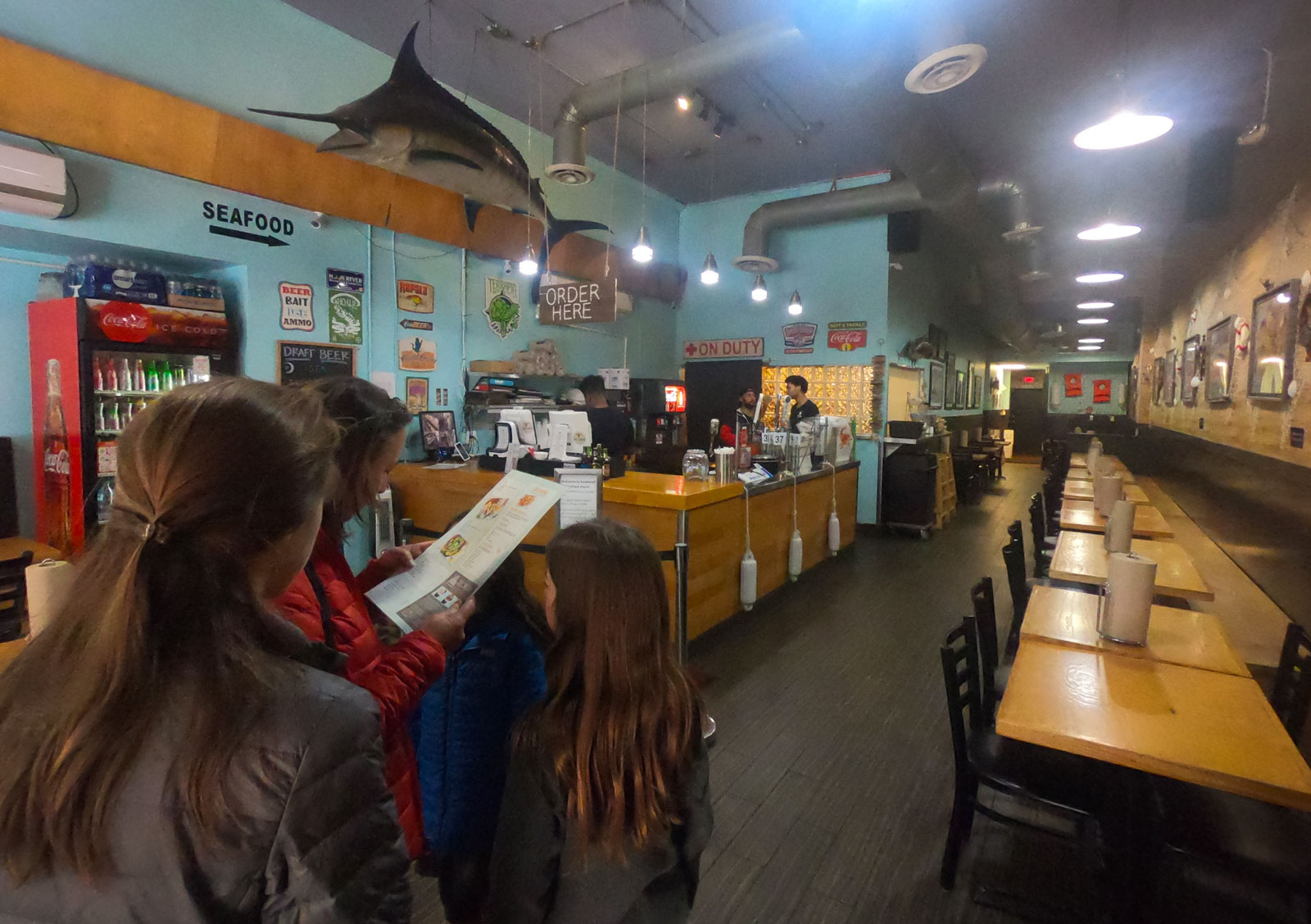 Family looking at Savannah Seafood Shack menu