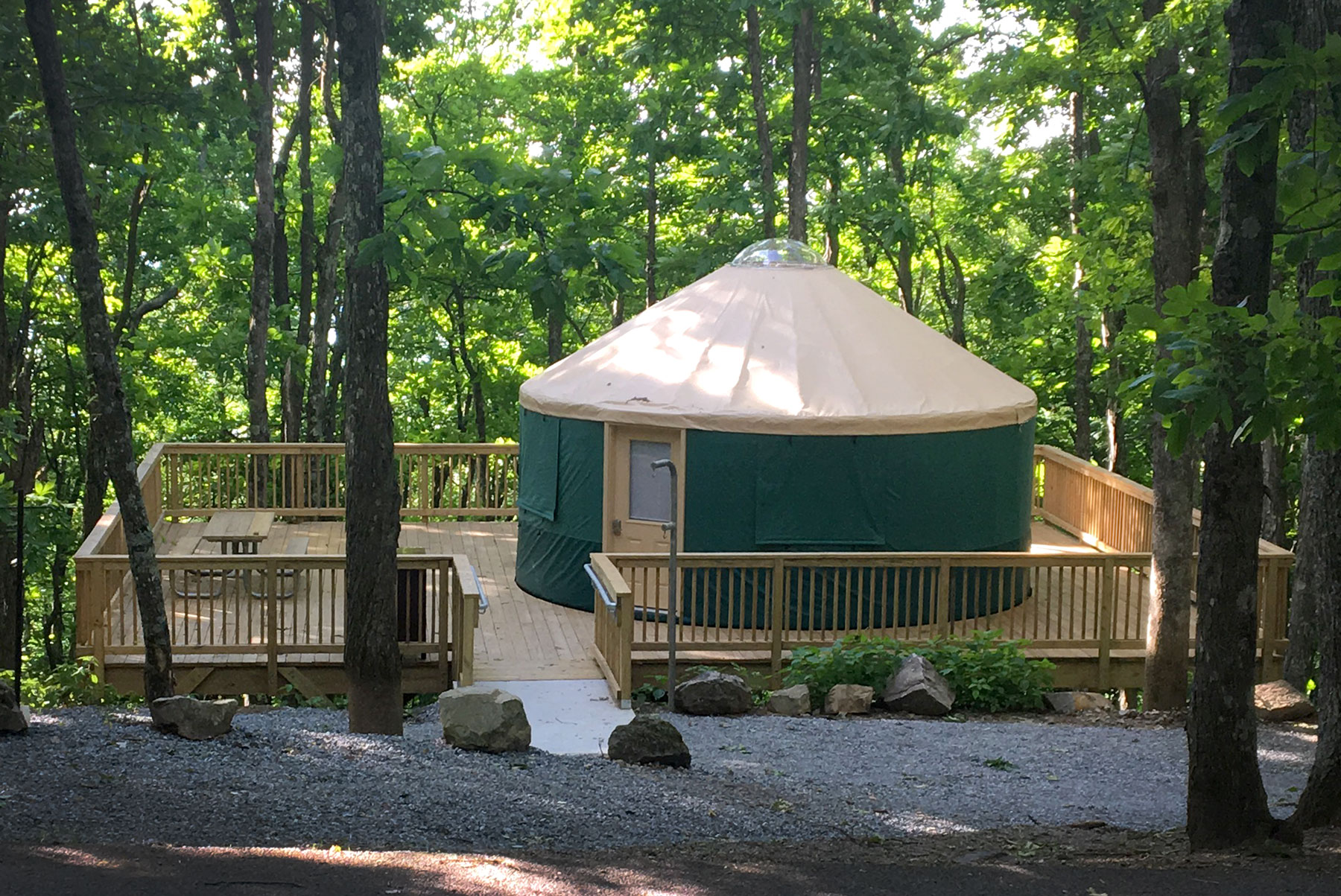Glamping in green yurt and wooden deck in the Hickory Ridge Campground at Grayson Highlands State Park, Virginia