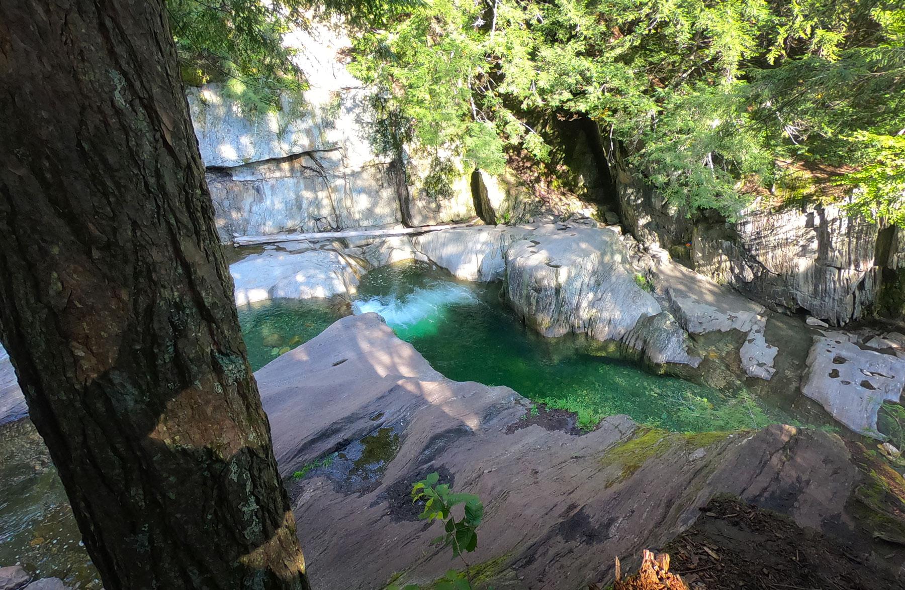 Overlook Warren Falls swimming hole in Vermont