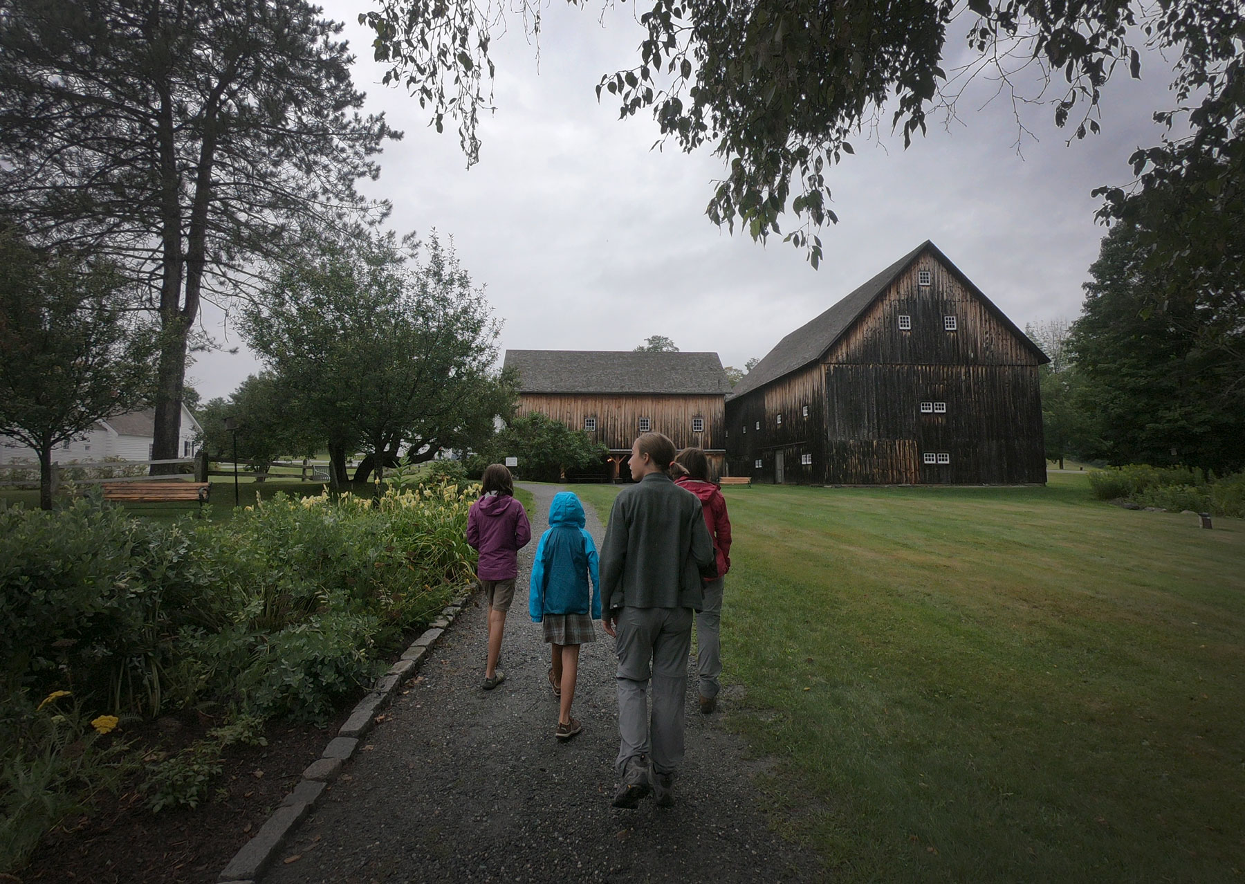 Four girls walking around Calvin Coolidge State Historic Site on a rainy day