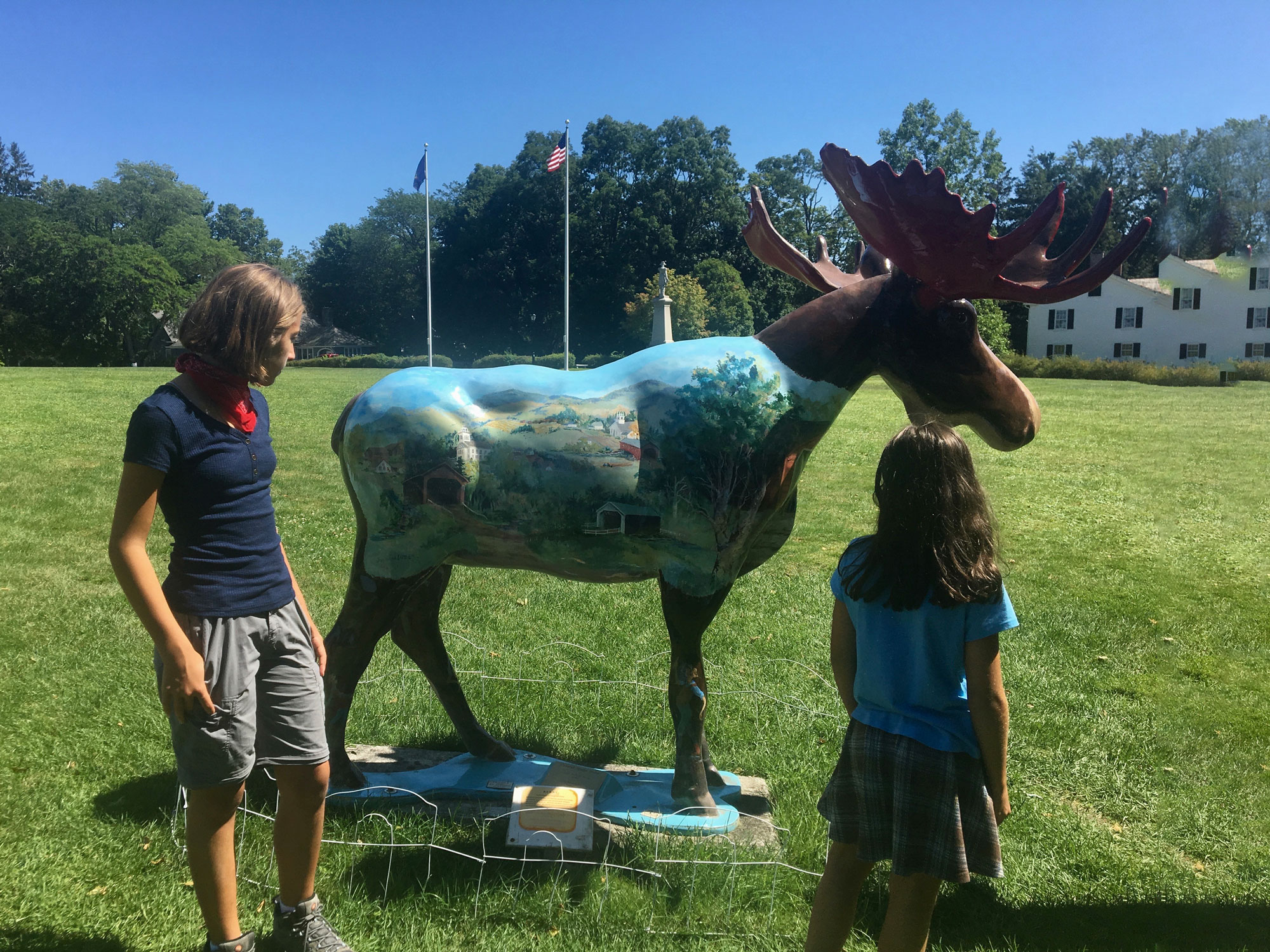 Two girls looking at Benny the Moose in Bennington, Vermont