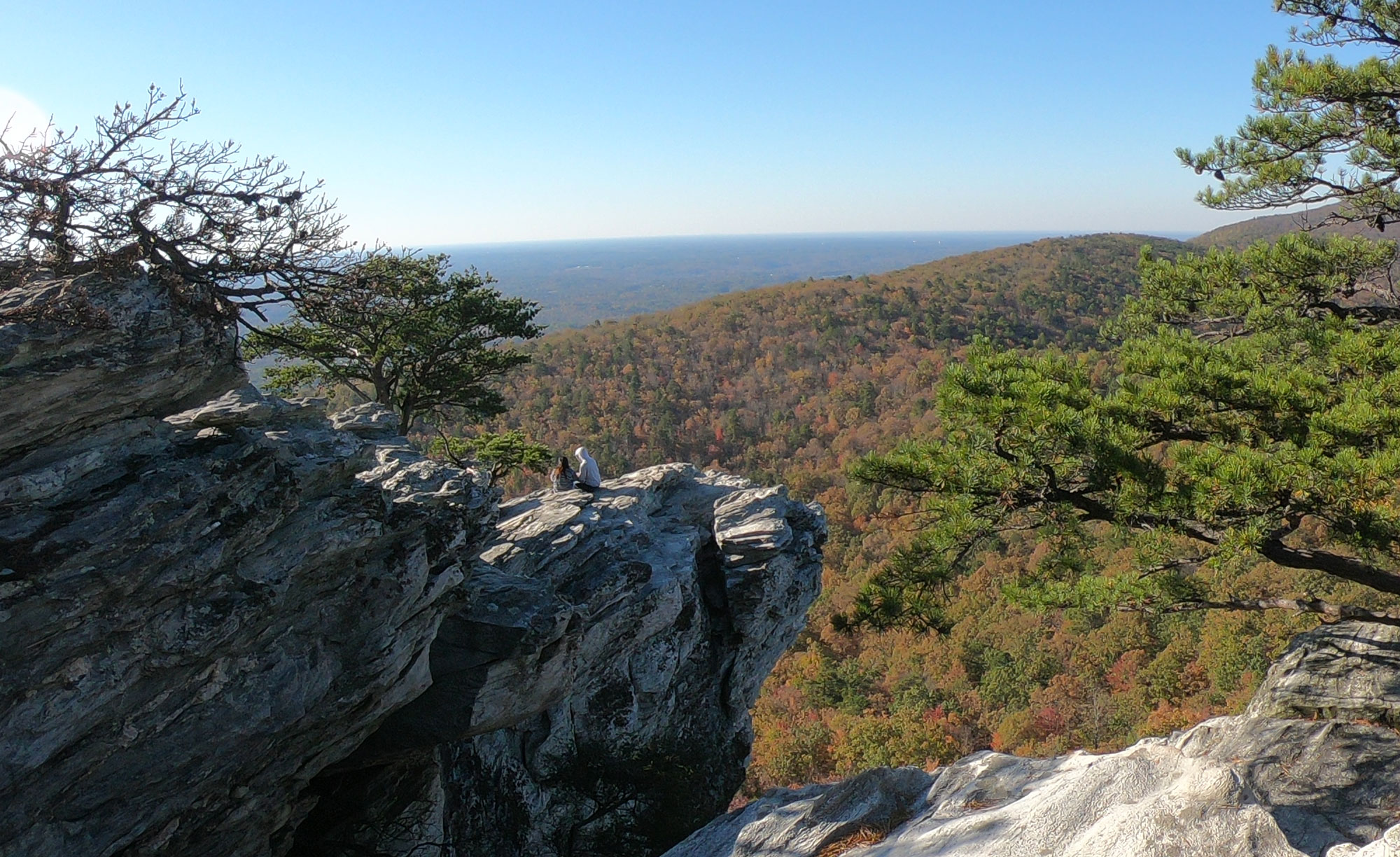 Two people hiked to Hanging Rock Overlook while camping in Hanging Rock State Park, North Carolina