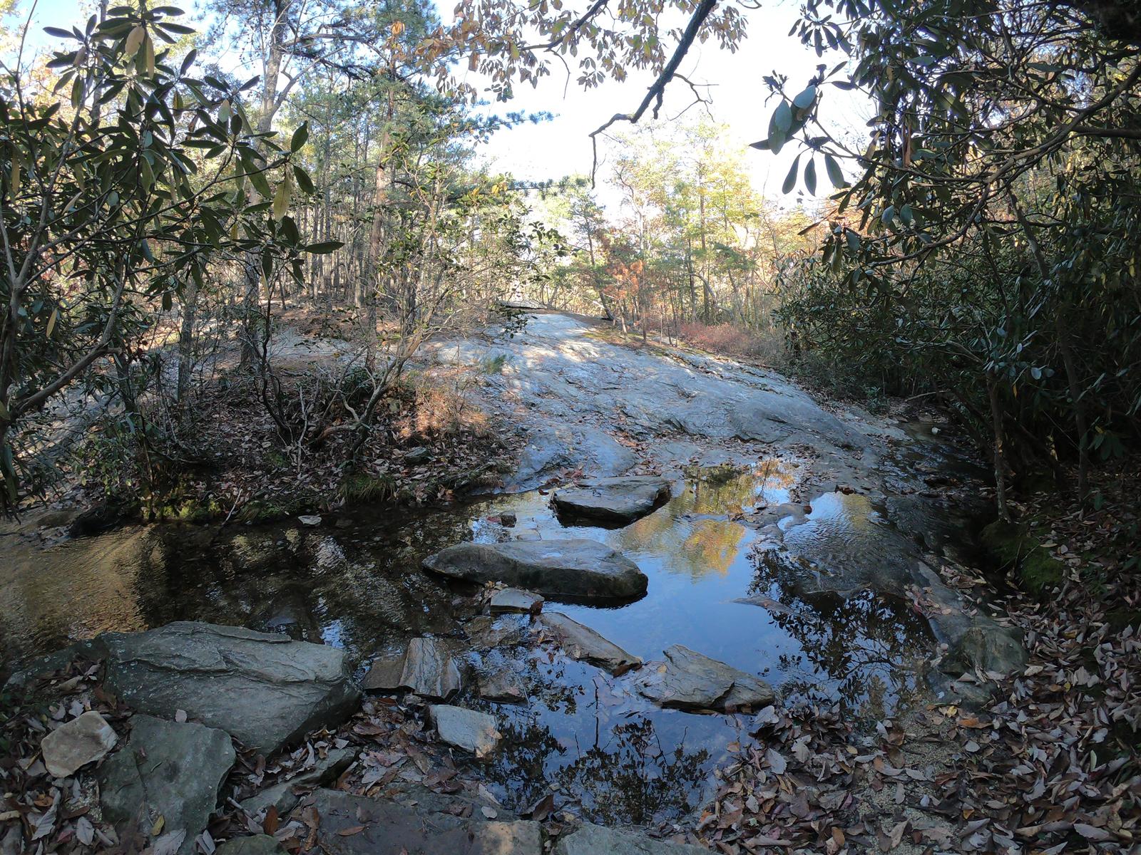 Hiking along the creek in Hanging Rock State Park, North Carolina