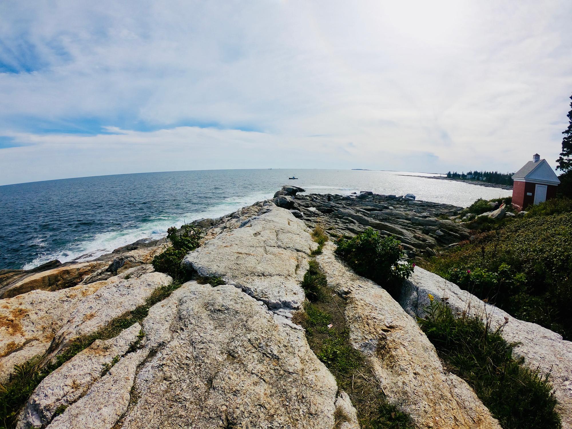 Rocky shoreline of Pemquid Point Lighthouse Park in Bristol, Maine