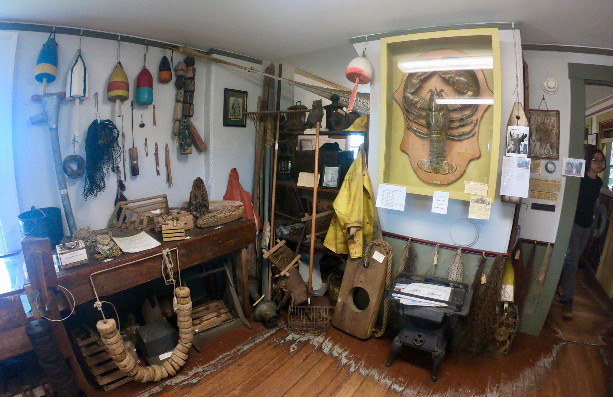 Interior maritime exhibits with lobster and fishing gear in Fishermen's Museum at Pemaquid Point Lighthouse Park, Bristol, Maine