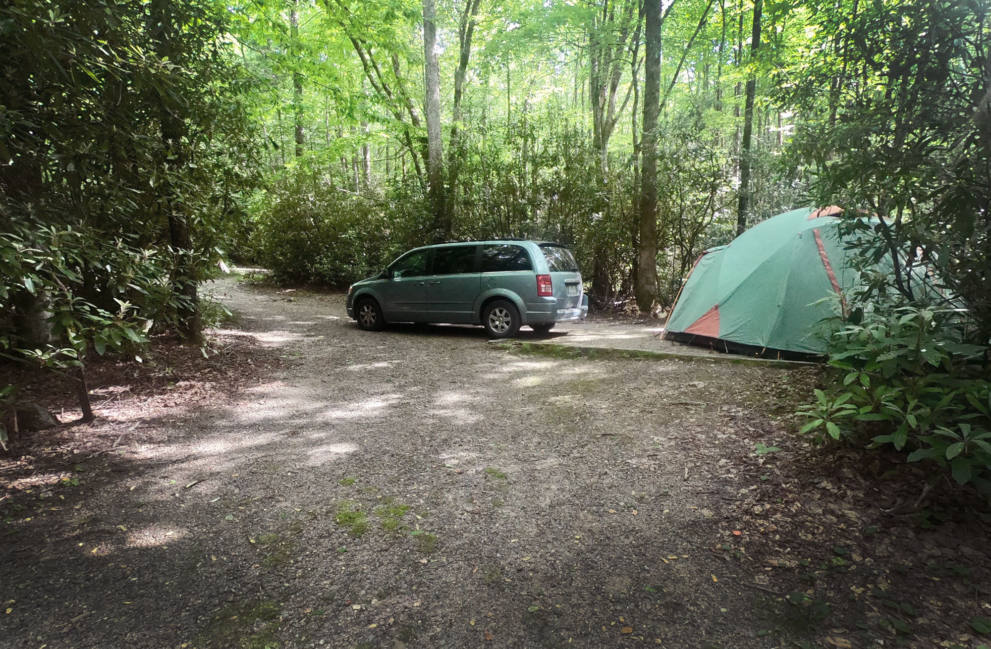 Standing Indian Campground campsite with van and green tent