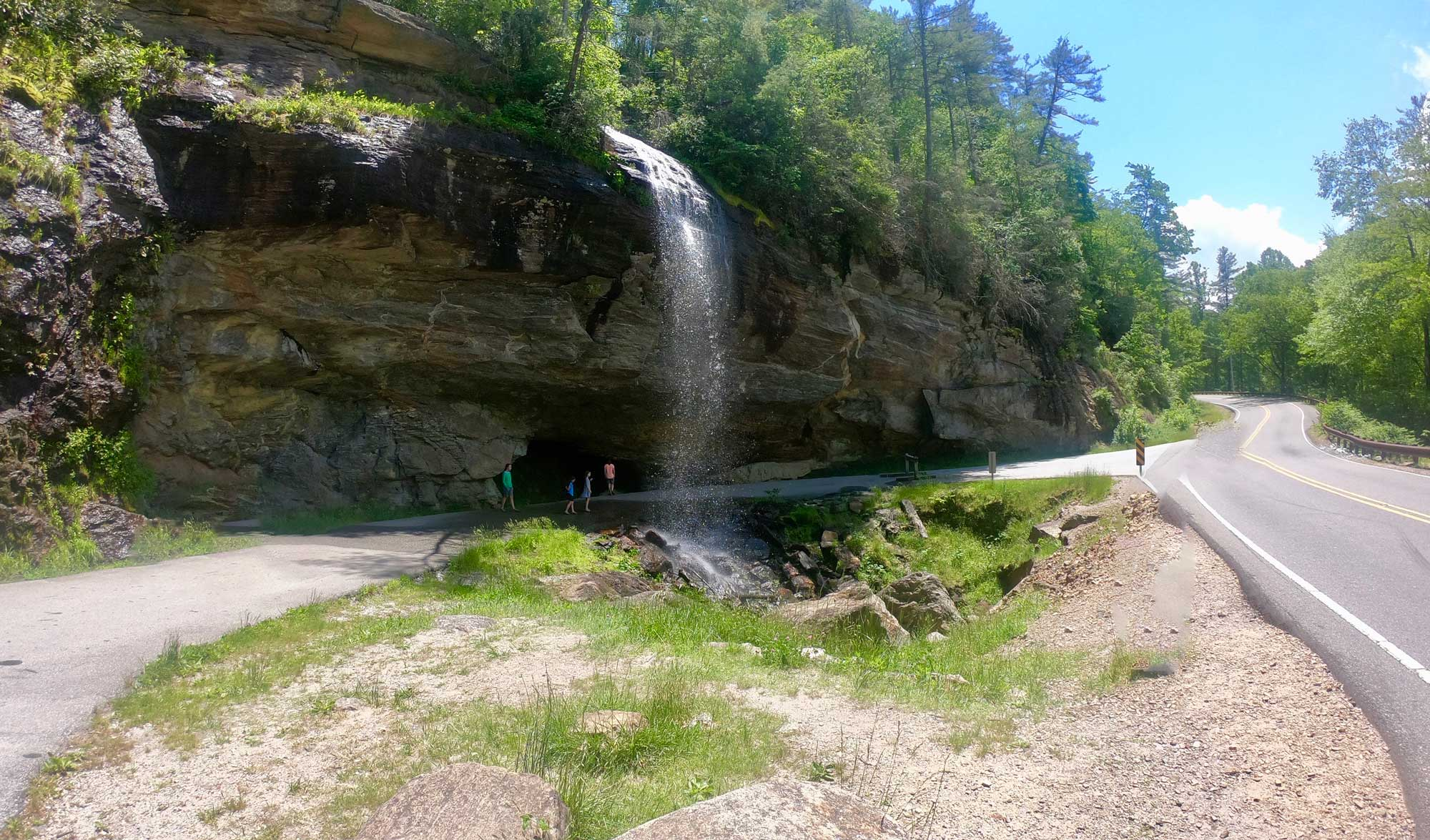 Kids playing under Bridal Veil Falls off Highway 64 near Standing Indian Campground
