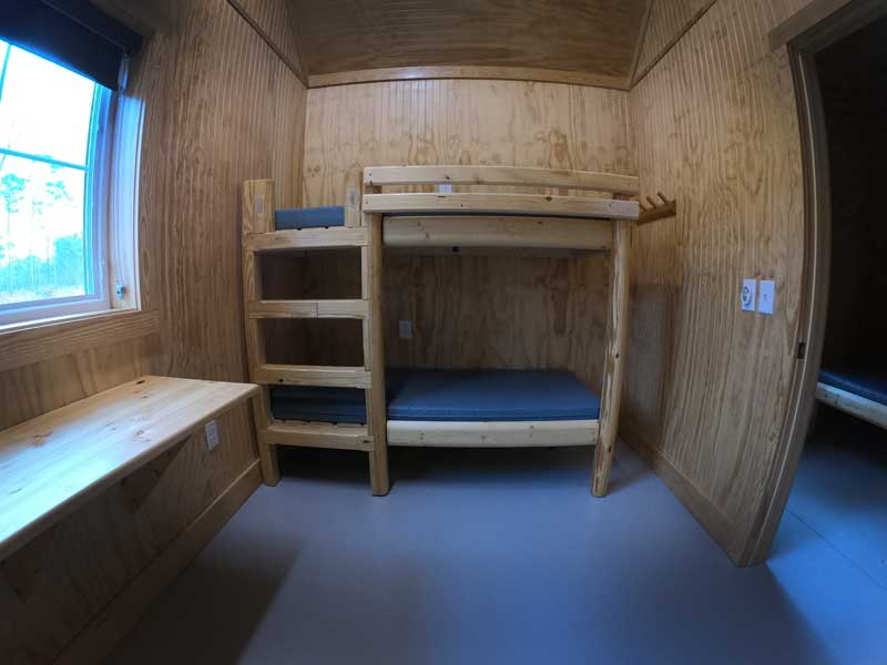 Interior view of bunk bed and desk view in camping cabins at Goose Creek State Park, North Carolina