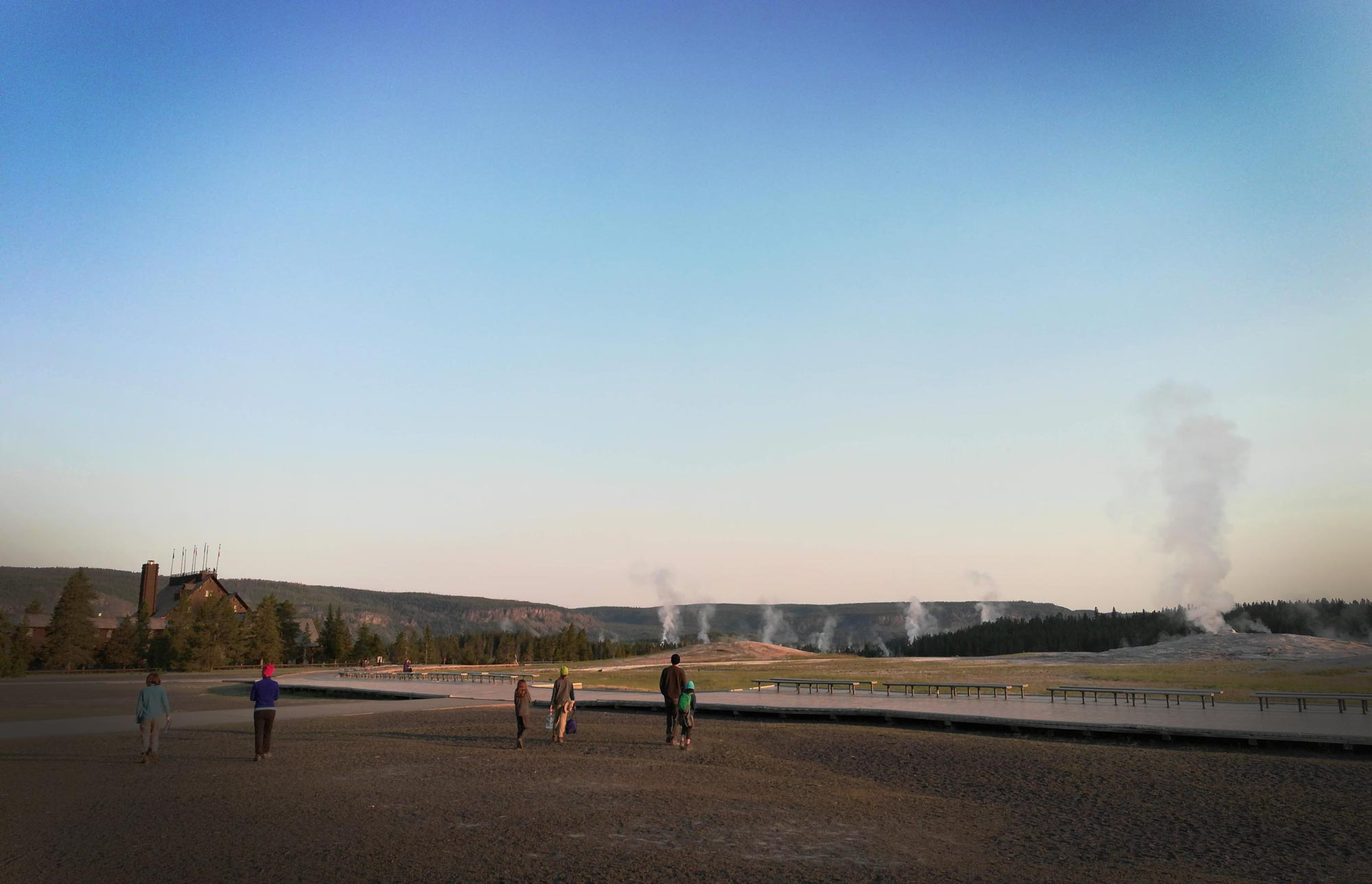 Early morning crowd at Old Faithful Geyser in the Upper Geyser Basin of Yellowstone National Park