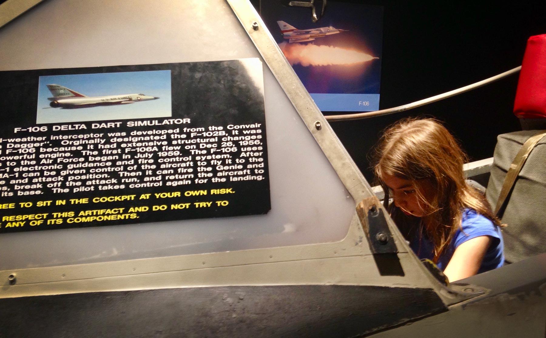 Girl in F-106 Delta Dart Simulator at the South Dakota Air & Space Museum