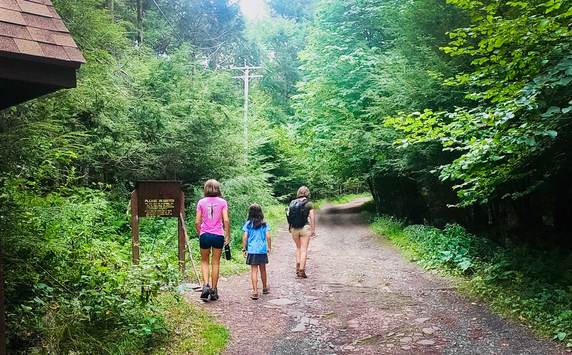 Three girls at the trailhead of the Overlook Mountain Trailhead, a former carriage road, in Catskill Mountains, New York