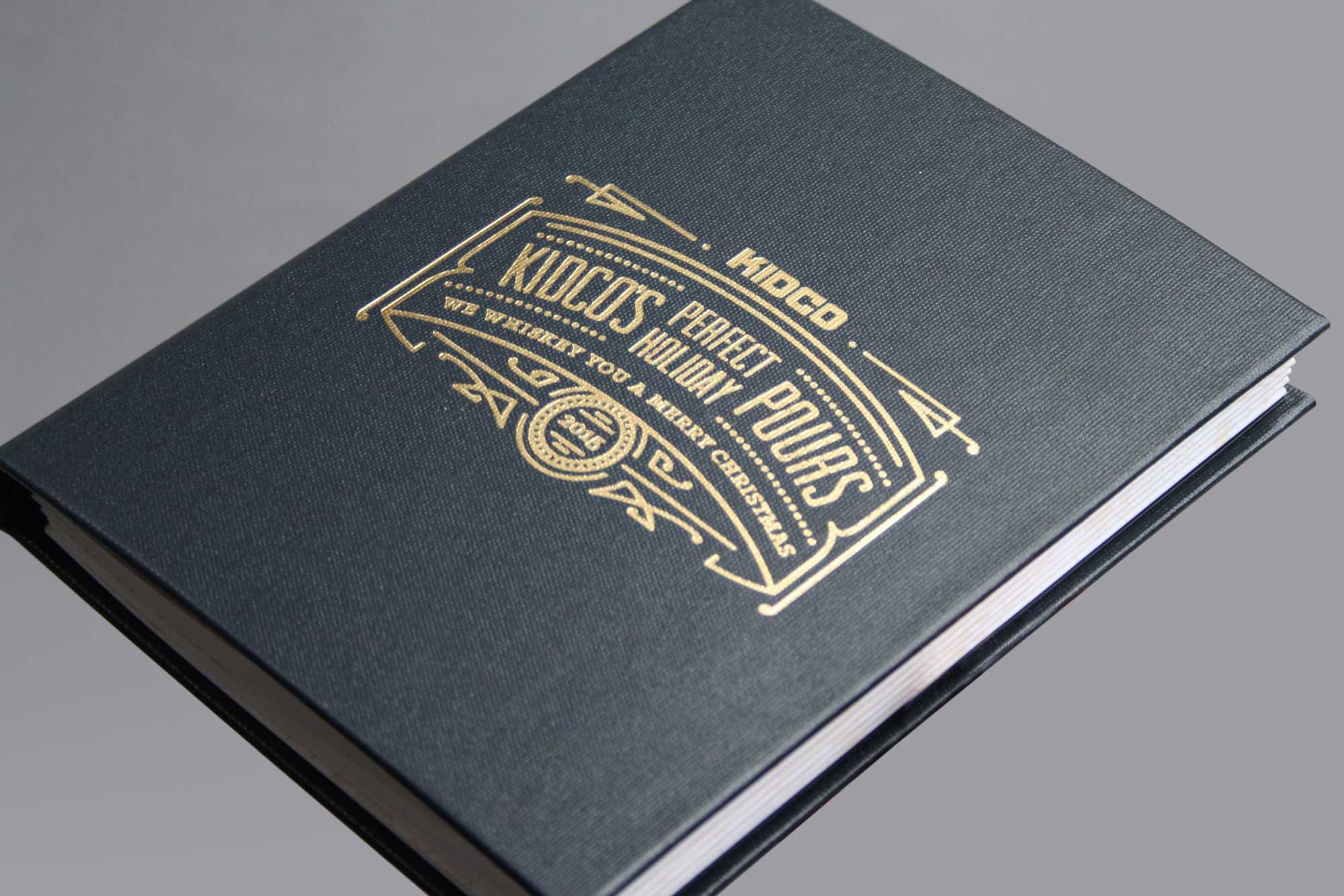 Custom corporate client gift whiskey cocktail book from Kidco construction in Calgary by Studio Forum