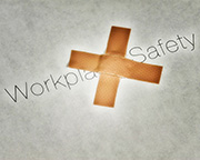 """Workplace Safety"" with a bandage on top of it"
