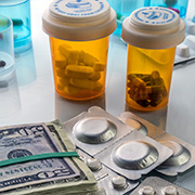 Prescription pill containers and $50 bills