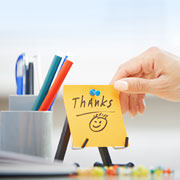 """Thanks"" Post-It note with a smiley face"