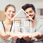 New homeowners holding up a drawing of a house