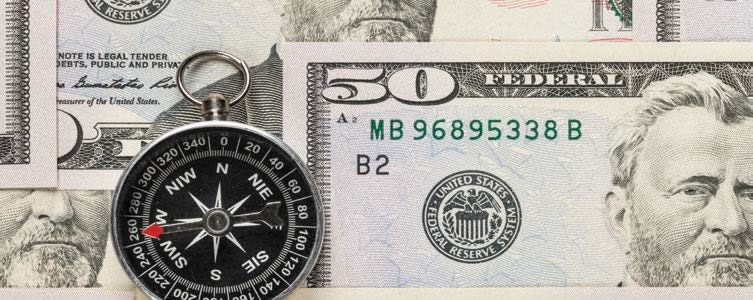 $50 bills and a compass