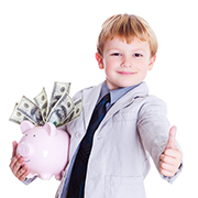 Kid holding a piggy bank overflowing with dollar bills