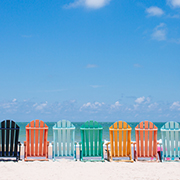 Row of adirondack chairs on the beach