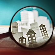 Looking through a magnifying glass of model houses