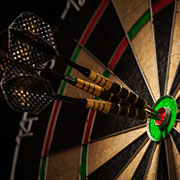 Dartboard with darts in the bullseye