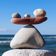 Stack of balancing rocks in front of the ocean
