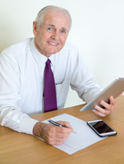 Elderly man filling out paperwork