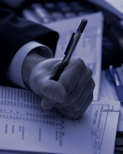 Hand writing on financial documents