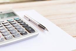 Calculator, pen, and paper