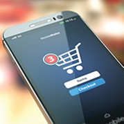 Phone with online shopping cart symbol