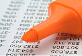 Orange highlighter on a financial page