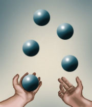 Pair of hands juggling 5 balls