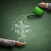 """Chalkboard drawing of a growing """"money tree"""""""