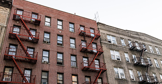 Brick apartment buildings with fire escape ladders