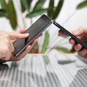 A pair of smartphones being held