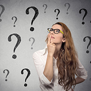 Woman thinking with question marks