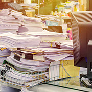 Several large stacks of office papers and files