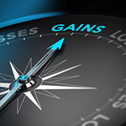 Compass needle pointed to the word 'Gains'