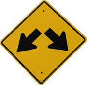 Road sign with 2 arrows going in different directions