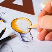 Artist drawing a lightbulb sketch