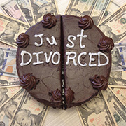 Chocolate cake cut in half with white icing text: 'Just Divorced'