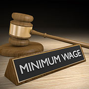 Gavel and 'Minimum Wage' sign