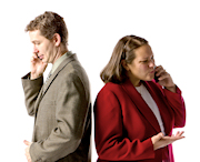 Man and woman standing back-to-back while on the phone.