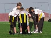 flag football team huddle