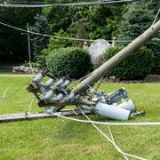 Broken electric line pole