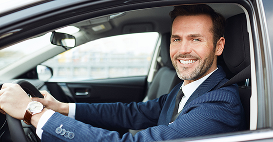 Smiling man sitting in a car