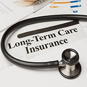 "Stethoscope on a document labeled ""Long-Term Care Insurance"""